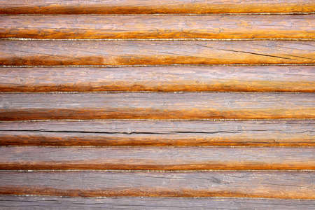 Brown wall as a background from wooden logs