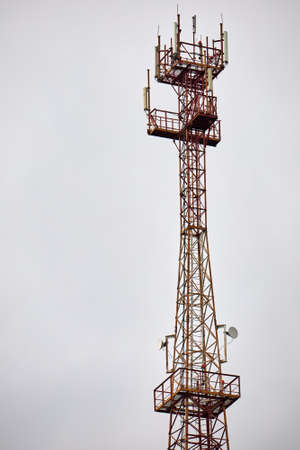 Telecommunications Cell Phone tower with mobile antennas on blue sky background