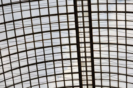 Glass-metal roof of the building of trade center