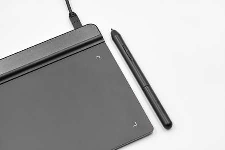 Graphic tablet and pen on white background
