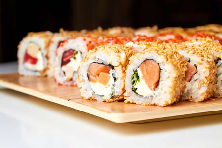 Set of various sushi rolls on a board. Close-up, selective focus Imagens