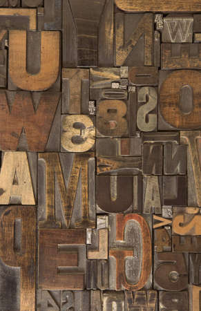 An assortment of old wooden and metal type blocks
