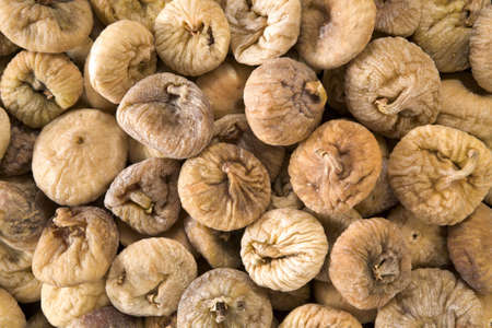 Textured background of dried figs Stock Photo
