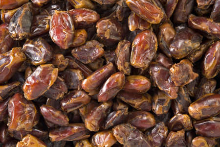 pitted: Textured background of pitted dates