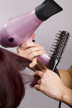 Close-up of hairdressers hands holding hairdressing equipment Stock Photo
