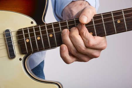Close-up of electric guitar player bending string Stock Photo - 4540634