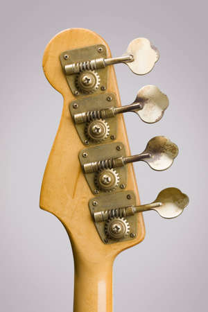 Rear view close-up of bass guitar tuning pegs photo