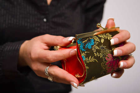 coin purse: Womans hands opening empty coin purse