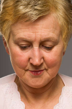 Portrait of mature woman looking down photo