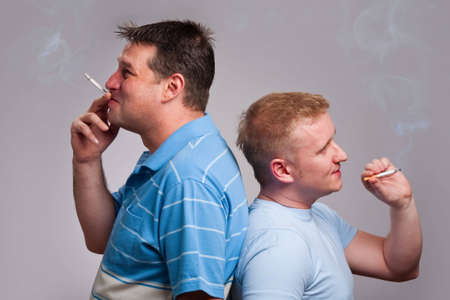 and the horizontal man: Two men back to back smoking cigarettes