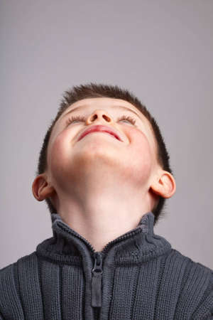 Portrait of little boy looking up into copy space Stock Photo - 5061914