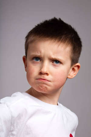 rebellious: Portrait of little boy with angry expression Stock Photo