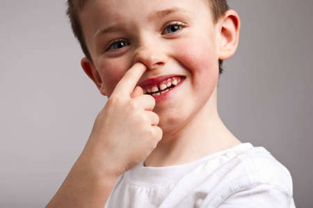 Portrait of little boy picking his nose