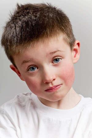 Sad little boy looking to camera