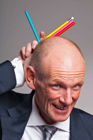 fooling: Businessman fooling around with colorful pencils
