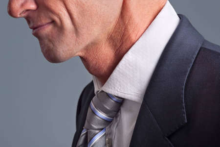 Close-up of businessman wearing white collar and tie photo