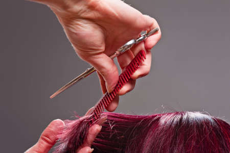 Close-up of hairdressers hands styling clients hair photo