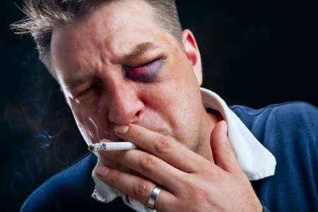 Portrait of hooligan smoking cigarette