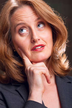 Businesswoman resting hand on chin with expression of contemplation Stock Photo - 6683426