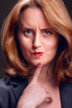 Portrait of thinking woman with index finger on chin Stock Photo - 6683424