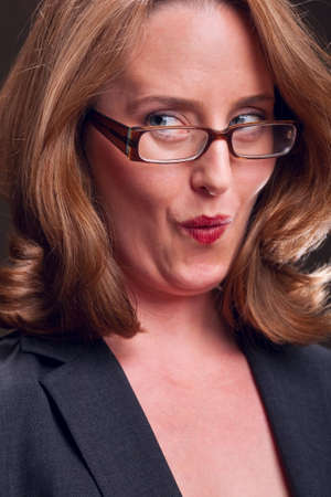 mischievous: Mischievous woman with sideways glance Stock Photo