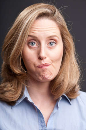 Blonde woman with quizzical facial expression