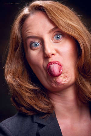 poking: Portrait of a rude woman sticking her tongue out