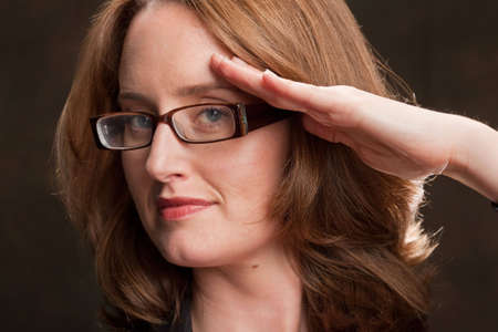 Portrait of a saluting businesswoman Stock Photo - 6820200