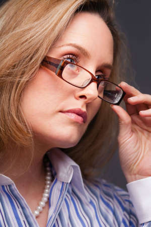 Close-up of woman wearing glasses and white collar striped business shirt Stock Photo - 6820133