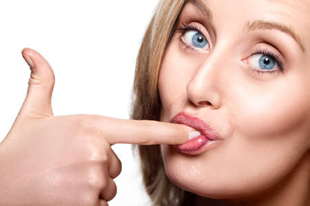 licking finger: Close-up of caucasian woman licking her finger Stock Photo