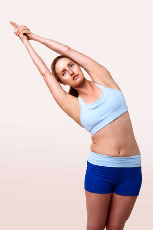 three quarter length: Three quarter length shot of athletic woman stretching Stock Photo