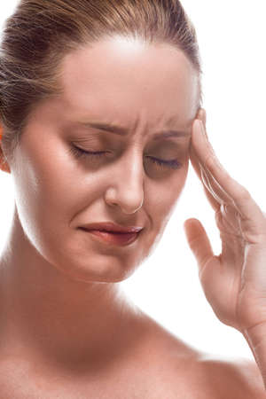 Portrait of Caucasian woman with headache on white background Stock Photo