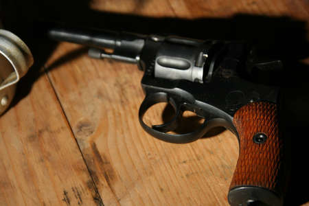 Gun on a wooden table