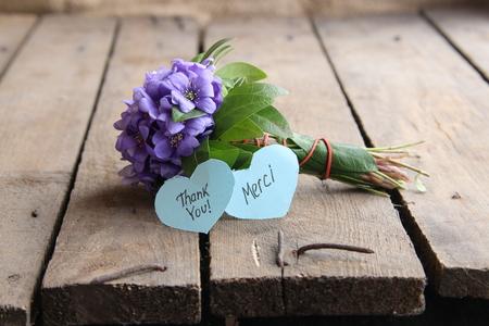 Merci written on tag