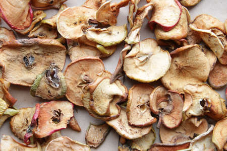 Dried apples on vintage style. Food background.