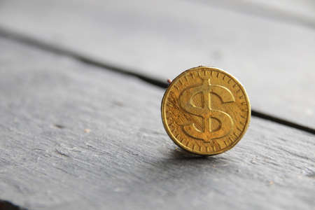 Business background. Gold dollar on vintage background.