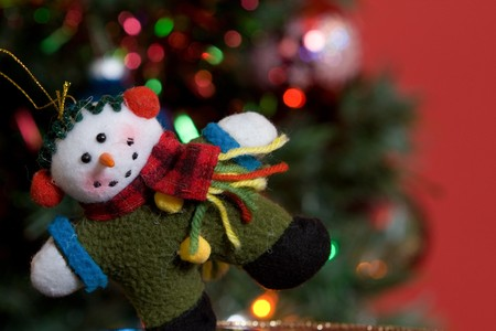 close up of a home made snowman ornament on a christmas tree. photo