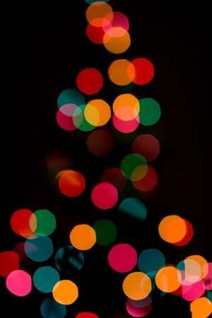 wish: focus dialed out to create this abstract shot of a lit christmas tree.  Shot with 85mm F1.2 lens at 1.8. Stock Photo