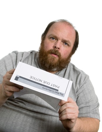 Man holding a past due notice and looking very worried Stock Photo - 8032531