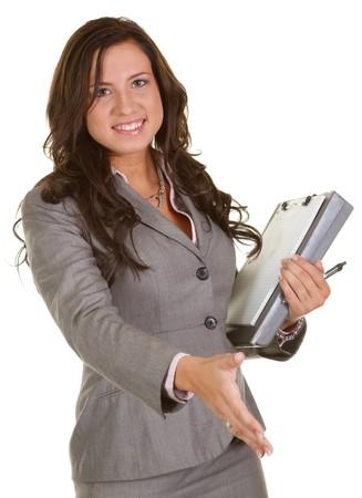 secretaria sexy: Joven empresaria extendiendo su mano a estrecharle la mano  Foto de archivo