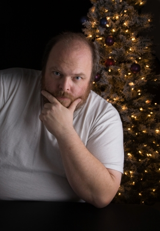 christmas debt: Middle-aged man dealing with seasonal depression Stock Photo