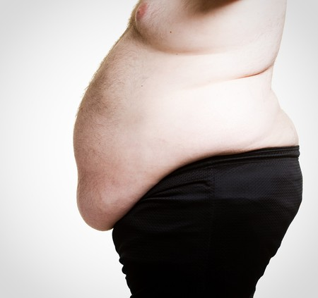 cropped shot: Cropped shot of an extremely obese mans belly Stock Photo