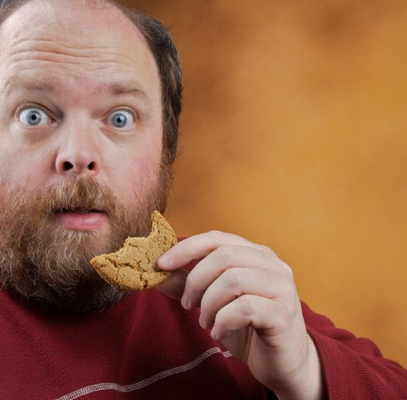 Overweight middle aged man with cookies Stok Fotoğraf