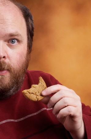 renounce: Overweight middle aged man with cookies Stock Photo
