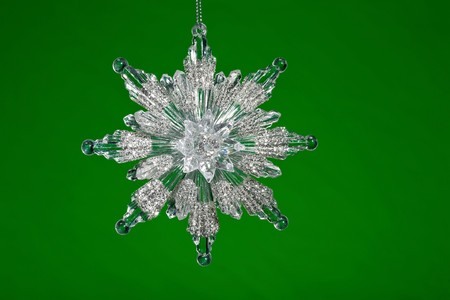 Crystal Snowflake ornament hanging on background photo