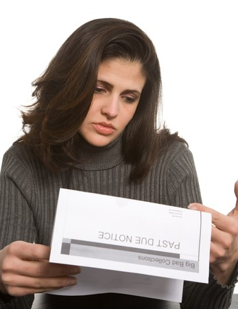 Young woman looks sad with past due notices in front of her photo