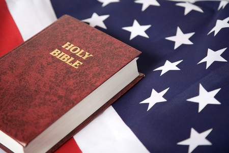 christian symbol: Bible laying on top of an american flag