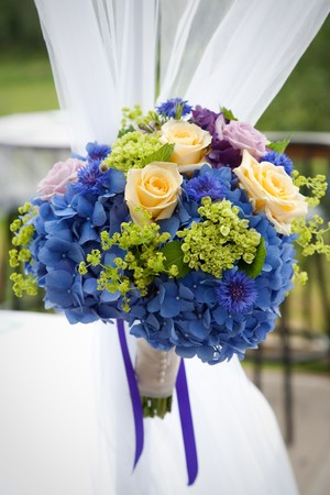 Bridal bouquet made from multi-colored flowers