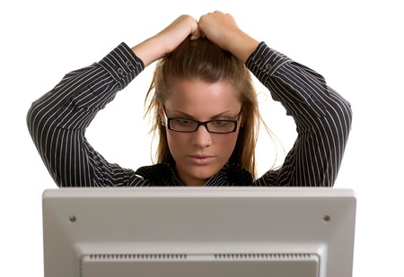 A young office worker pulls her hair in frustration of a computer crash. photo