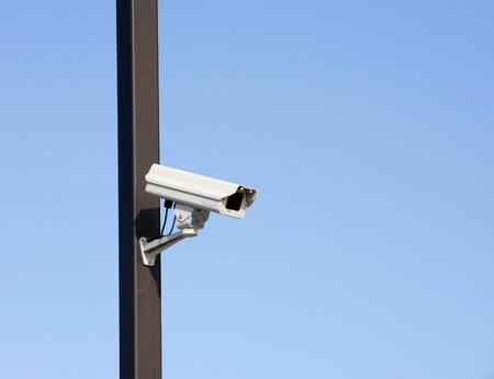 surveillance camera on light pole in parking lot photo